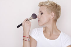 Make-up artist holding brushes Stock Photography