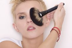 Make-up artist holding brushes Stock Photos