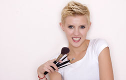 Make-up artist holding brushes Stock Image