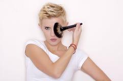 Make-up artist holding brushes stock photography