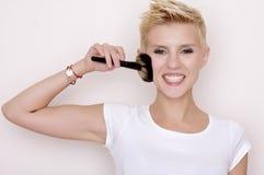 Make-up artist holding brushes stock images