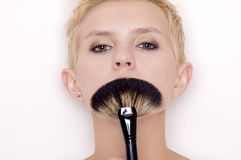 Make-up artist holding brushes Royalty Free Stock Image