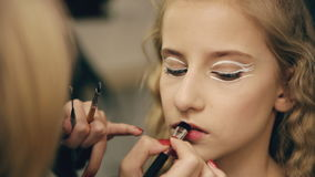 Make-up artist makes young actress girl beautiful makeup for lips before dancing perfomance indoors stock video footage