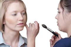 Make-up artist with model Royalty Free Stock Photography