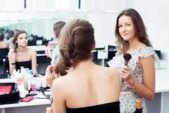 Make-up artist and model Royalty Free Stock Images