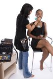 Make-up artist and model. Stock Photography