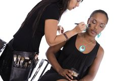 Make-up artist and model. Stock Images