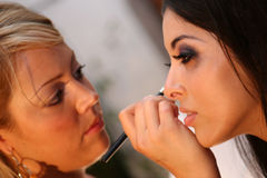 Make-Up Artist and Model Royalty Free Stock Image