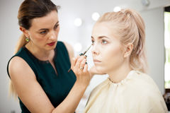 Make up artist at the studio in working process Royalty Free Stock Images