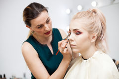 Make up artist at the studio in working process Royalty Free Stock Photography