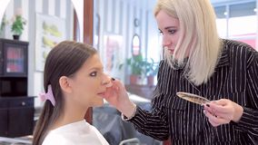 Make-up artist is using foundation in models make-up stock footage