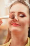 Make up artist visagiste using brush. Stock Photo