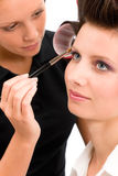 Make-up artist woman fashion model apply eyeshadow. With brush Royalty Free Stock Photography