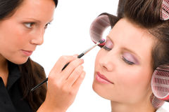 Make-up artist woman fashion model apply eyeshadow. With brush Stock Photos