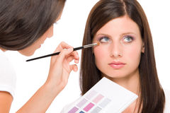 Make-up artist woman fashion model apply eyeshadow Royalty Free Stock Image