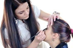 Make-up artist woman fashion model apply eyeshadow Royalty Free Stock Photo