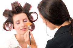 Make-up artist woman fashion model apply powder. Blush rouge brush Stock Photos