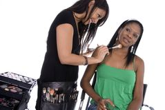 Make-up artist at work. Stock Photos