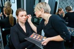 Make up artist at work. Make up artist applying make up on model Royalty Free Stock Image
