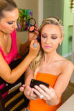 Make-Up artist at work applying make up Stock Image
