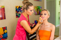 Make-Up artist at work applying make up Royalty Free Stock Photography