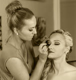 Make-Up artist at work applying make up Royalty Free Stock Photos