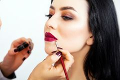 Make-up artist work in her studio. Royalty Free Stock Photography
