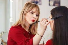 Make-up artist work in studio Stock Image