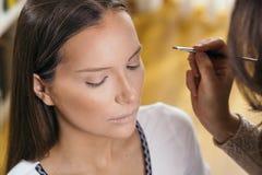 Make up artist working stock photos