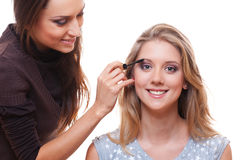 Make up artist working with model Royalty Free Stock Photo
