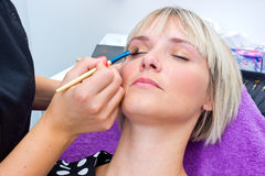 Make up artist working on model Royalty Free Stock Photos
