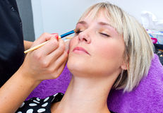 Make up artist working on model Royalty Free Stock Photo