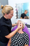Make up artist working on model Royalty Free Stock Photography