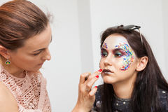 Make-up artist working on a model before photo shooting Royalty Free Stock Photography