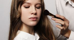 Make-up artist doing make-up beautiful girl, beauty concept and Royalty Free Stock Images