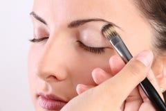Make-up artists apply makeup model Royalty Free Stock Photo