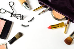 Make up bag with cosmetics and brushes isolated on white Stock Photography