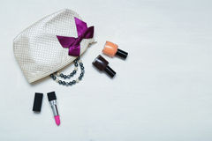 Make up bag with cosmetics and brushes on wooden background Royalty Free Stock Images