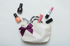 Make up bag with cosmetics and brushes on wooden background Stock Image
