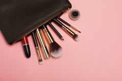Make up bag with cosmetics isolated on pink background royalty free stock photos