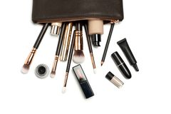 Make up bag with cosmetics isolated on white stock image