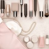 Make up bag with cosmetics located on the white wooden backgroun Stock Photos