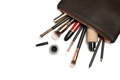 Make up bag with cosmetics on white stock photos