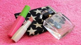Make up bag and perfume Stock Photo