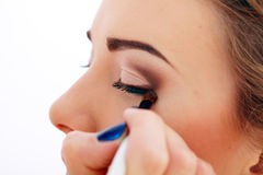 Make up the beautiful model. Stylist causes make up the beautiful model Stock Images