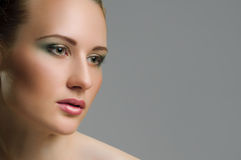 Make-up. Beautiful model with green make up Royalty Free Stock Images