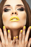 Make up. Beautiful model portrait with yellow lips Stock Images