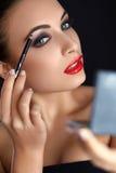 Make-up. Beautiful Woman Doing Makeup. Eyebrow Pencil. Red Lips Stock Images