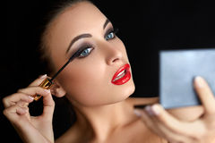 Make-up. Beautiful Woman Doing Makeup. Mascara Brush. Red Lips Royalty Free Stock Image