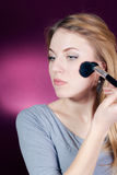 Make up by Beautiful young woman Royalty Free Stock Photography
